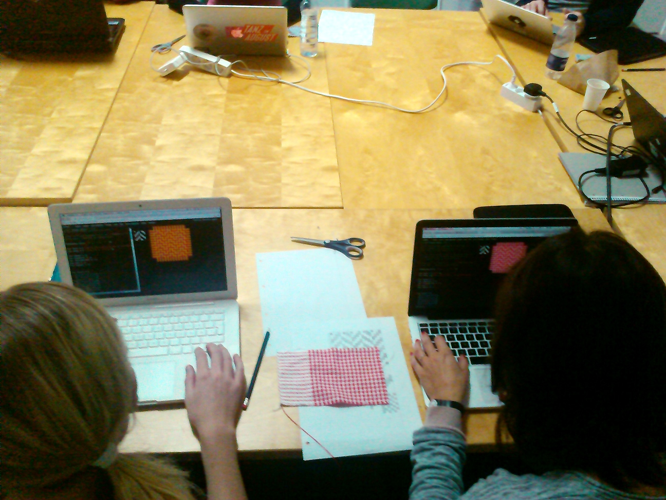 Two workshop participants programming patterns